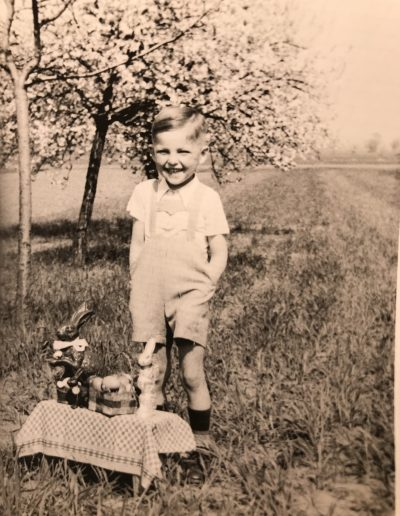 Little Frankie near Laudenbach Germany circa 1952. Easter treats purchased with money sent from Canada by Adam.
